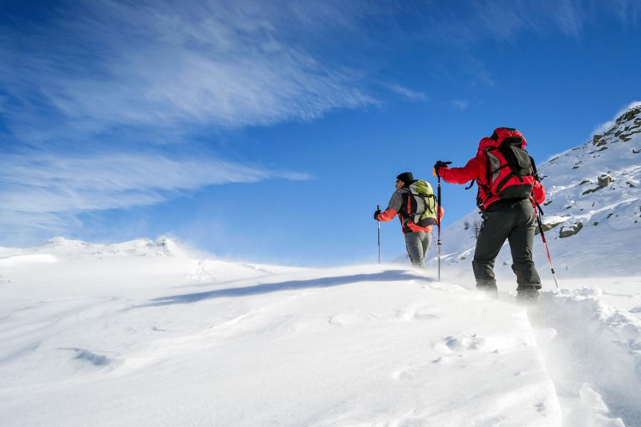Two men trekking in powder snow