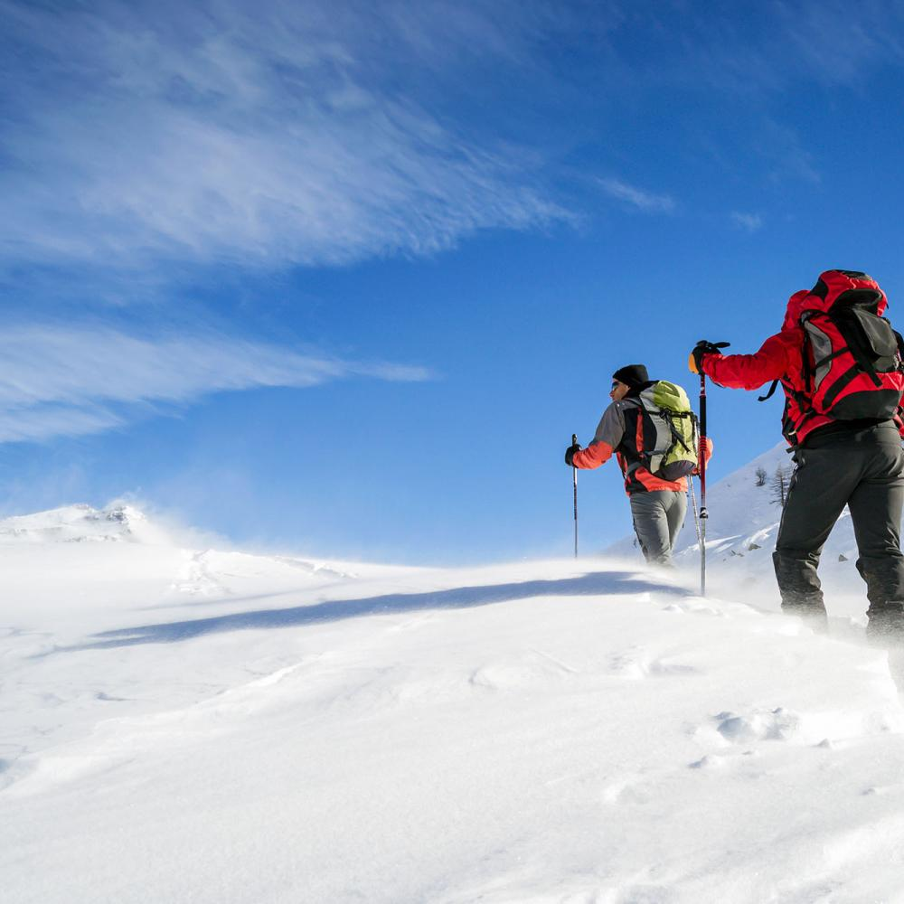 Men trekking in deep snow
